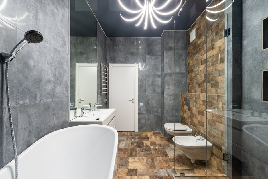 A large tub next to a shower